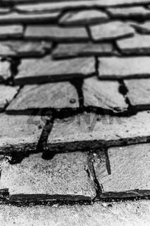 Pattern of rectangular stony pathway slabs