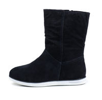 Side view of black suede boot