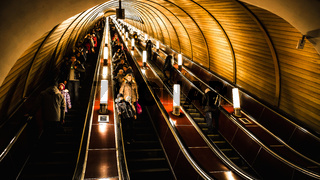Moscow, Russa - February 22, 2015: Deep subway station is crowded with people riding the escalators down
