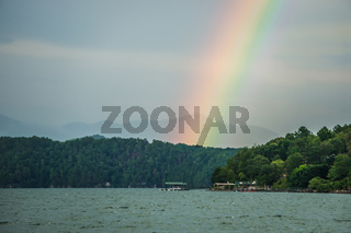 rainbow after thunderstorm at lake jocassee south carolina