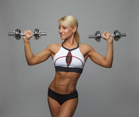Athletic woman doing exercise for arms