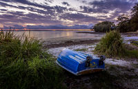 The little blue rowboat on the shore
