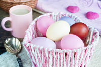 Basket with colorful, painted eggs at Easter