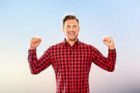 Exultant man cheering a personal success