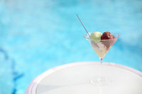 Italian gelato or ice cream in crystal bowl by the pool