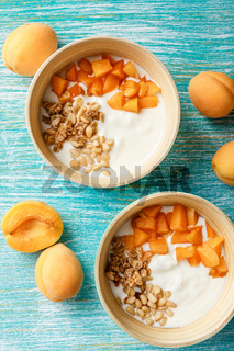 Homemade yogurt with granola, apricot and pine nuts