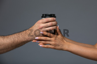 Cups With A Coffee In The Hands Of Men And Women.