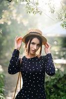 Girl in hat posing on camera