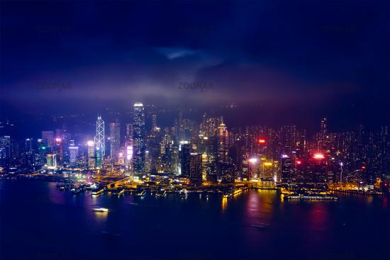 Aerial view of illuminated Hong Kong skyline. Hong Kong, China