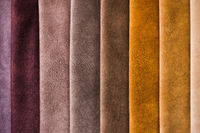 Colorful and bright fabric samples of furniture and clothing upholstery. Close-up of a palette of textile abstract stripes of different colors