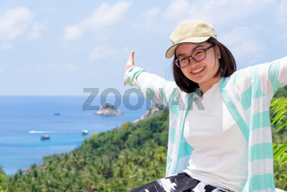 Women tourists extend the arms happily