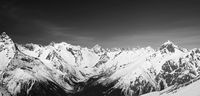 Black and white panorama of snow covered mountain peaks