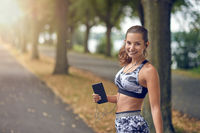 Attractive sporty woman with her mobile phone
