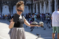Tourists feed pigeons, Piazza di San Marco, St. Mark´s Square, Venice, Italy, Europe