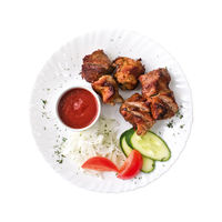 Skewers and tomato sauce on the plate, isolated on white background. Top view