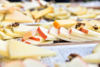 Buffet of cheeses of many types on a table served in Mediterranean diners.
