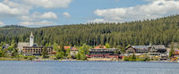 Lake Titisee with hotel buildings and church Christkönig, Titisee-Neustadt in the Black Forest