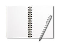 Blank open spiral notebook and pen isolated on white
