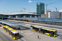 City buses arriving at bus station near railway station Utrecht