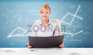 Business person sitting at desk with financial change concept