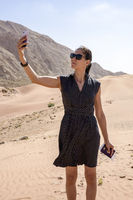 Lady taking Selfie in the desert