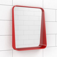 Mirror in the bathroom on tiled wall