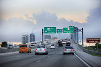Cars moving on a highway with directional signs to Miami International airport