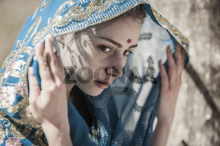 Face, sari and shadows