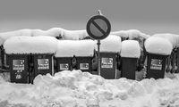 Snow-covered litter bins