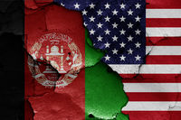 flags of Afghanistan and USA painted on cracked wall
