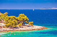 Idyllic Adriatic stone beach near Primosten view