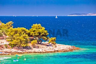 Idyllic Adriatic stone beach near Primosten view