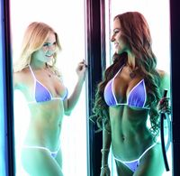 Sexy young women posing in tanning booth