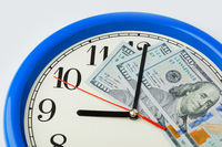 Clock and money - business concept