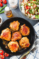 Delicious fried chicken thighs in a cast iron skillet