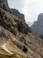 People Walking Along a Tight Trail in the Mountains 2