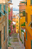 Old downhill street leading to the port in Genoa