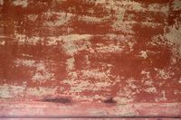 Flaking tone-colored wall paint