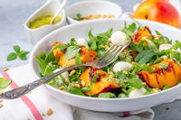 Salad with grilled nectarines, arugula and pesto.