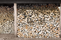 stacked firewood in wood shed