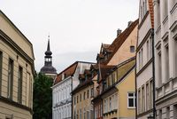 Traditional colorful houses and church tower in the old town of Stralsund
