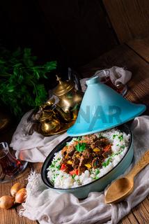 Tajin beef stew with rice paprika and sesame seeds