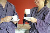 Loving couple in bathrobe drinking coffee in the morning