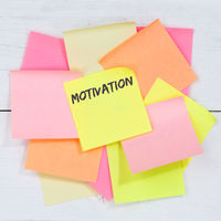 Motivation strategy coaching training success successful business concept desk note paper