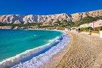Baska. Idyllic pebble beach with high waves in town of Baska, Island of Krk