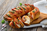 Roasted baguette with herb butter and Salami
