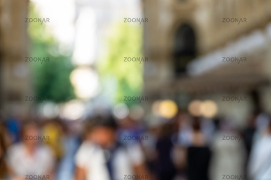 An image of walking people blurred background