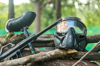Paintball mask set and gun. Paintball mask hit in glasses after play. A paintball gun and a mask pla