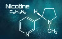 Chemical formula of Nicotine on a futuristic background