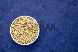 oat groats in a glass bowl